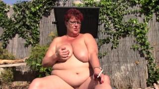 Busty Naked Mature BBW Smokes In Garden